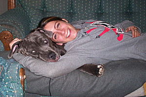 Schroeder the pit bull getting a snuggle from her mom