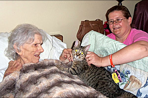 Casandra visiting a resident in a retirement home