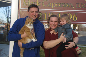 Skippy the cat was adopted at National Cat Caretakers Day. Here, he is pictured with his adoptive family.