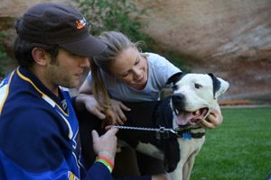 St. Louis Blues NHL player David Backes and wife, Kelly, with Vince the pit bull dog