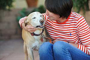 Jennifer Hubbard with her arm around a dog