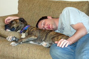 Jeremy and Penny the dog during a sleepover