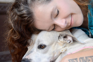 Animal advocate and musician Neko Case snuggling with a dog