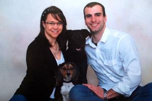 Black Labrador retriever mix Nova with his family