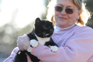 Orson the cat and Robin a caregiver
