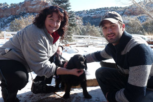 Vicki and James Dixon at Best Friends Animal Sanctuary with a black dog