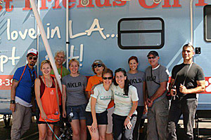 Volunteers in front of mobile animal adoption van