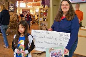 Eight-year-old Violet Schultz presenting a check to Best Friends Animal Sanctuary to help the animals