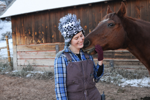 Rocky the horse who has hoof problems with a caregiver
