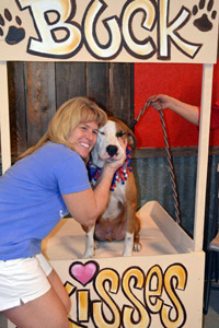 Tammy Dalton with a dog volunteering at an adoption event back home in Houston, Texas