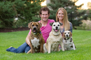 Kelly and David Backes with their canine family