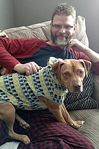 Lakota the dog rescued from a dogfighting right with his adoptive dad Steve