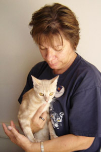 Barbara gets a cuddle from a cat at Best Friends Animal Sanctuary
