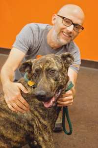 Moby petting a dog at Best Friends