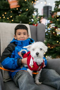 Armando Jr. wrote a letter to Santa asking for a dog. Here is Armando with Gaston the dog.