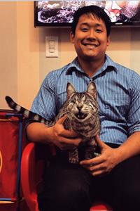 Derek Wang with eyeless silver tabby cat Ricky Bobby