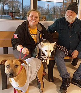 Heather and James Savee, their dog Leia, and Honey the shy Lab dog on the meet and greet at the shelter