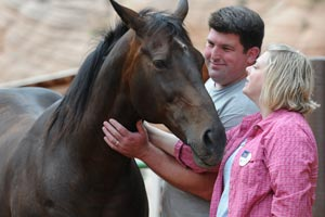 Volunteers Megan and Matt Claflin at Best Friends Animal Sanctuary with Lady the horse