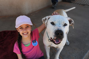 Girl named Kailey with Big Bob the pit bull