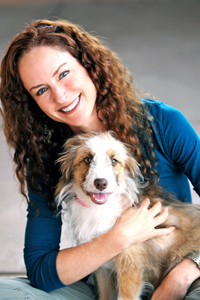 Elizabeth Oreck, national manager of Best Friends' puppy mill initiatives, holding a dog