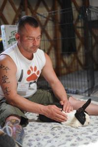 Shawn performing Reiki on Sadie the rabbit