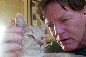 Rio the once-paralyzed cat with Bill