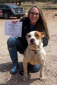 Anton the dog gets his diploma for passing his training