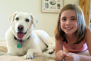 Mama Stormy the Labrador mix, now Chessa, has learned that people are her friends