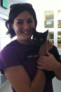 Suki the cat held by Stacy Sanders at Free Fix LA