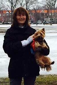 Taz the rescued silky terrier dog and his adopter Margaret