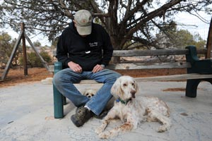 Volunteer dog transporter Bill Splitter with two dogs