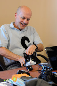 Devin the formerly distrustful cat with Dr. Frank on his lap