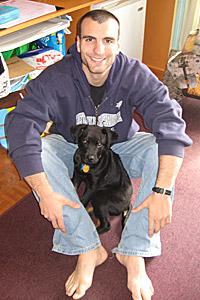 Eric with Nova black Labrador retriever mix as a puppy
