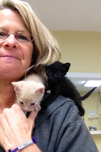 Foundation Against Companion-Animal Euthanasia's TNR expert Lisa Tudor with two kittens