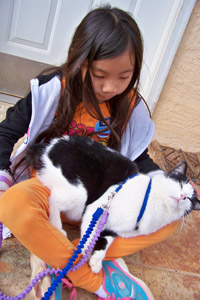 Violet Schultz with Bob the cat at Best Friends Animal Sanctuary