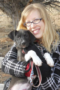 Vet tech student Elycia Degenhardt with Darla the puppy at Best Friends Animal Sanctuary