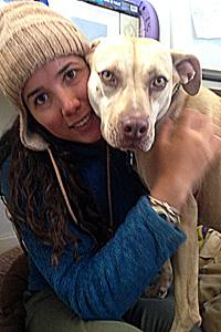 Lindsey Fontana hugging a pit bull dog