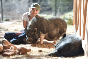 Kat Lucas from Hamburg, Germany, and Cherry the pig