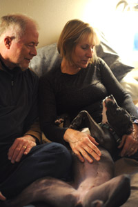 Melanie and John Dutcher, married couple volunteers, with Saydi the dog
