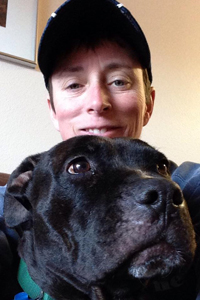 Volunteer Laura's selfie with Lordes, a big black dog